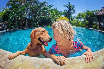 Woman and dog on holiday together